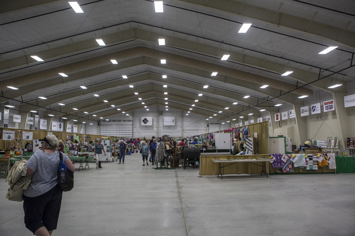 Wide interior photo of the Nordby Exhibit Hall with exhibits and visitors.