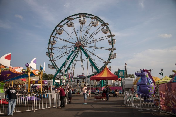 Outdoor photo of various rides at the South Dakota State Fair, by Goldstar Amusements.